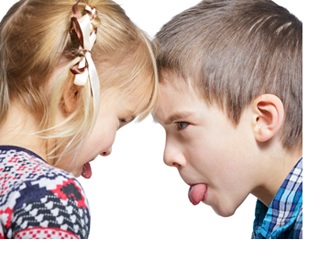 Sister and brother stick out tongues to each other