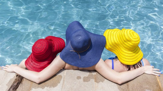 bigstock-girls-hats-pool-112322840